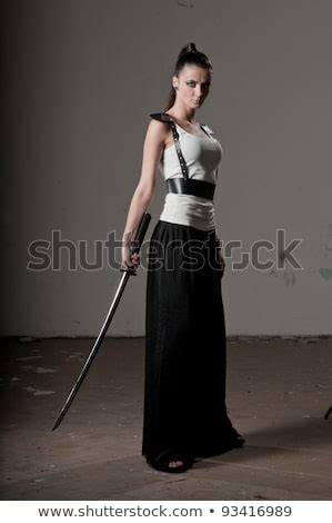 Woman Sword Stock Images, Royalty-Free Images & Vectors